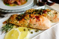 This recipe is one that will change the minds of salmon-skeptical everywhere. The rosemary & lemon combination is so incredibly yummy, especially with crispy seared skin and the garlic chip and caper garnishes, that I dare you to find someone who does not like it. The one caveat - use fresh salmon for best results and get to tryin'!
