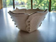 Lovely bowl:  I like the shape of each section and how the overlap is integral to the design.