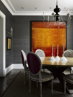 Muted grey grasscloth is the perfect backdrop for a bold tangerine piece of art.