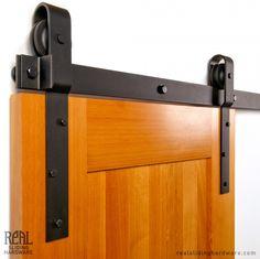 Real Sliding Hardware - Heavy Duty Industrial Barn Door Hardware (800lb), $1,417.00 (http://www.realslidinghardware.com/industrial-duty-flat-track-hardware-kit/)
