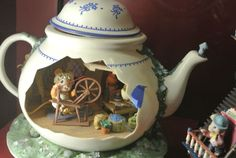 miniature teapot a little lady mouse at her spinning wheel. Too cute!