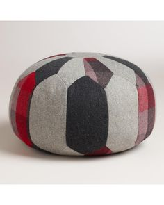 We're loving this wool patchwork pouf! Get it here: http://www.bhg.com/shop/world-market-round-patchwork-pouf-p525fa145e4b09b199db8ab98.html