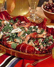 Grilled Seafood Salad  Per serving: 185 calories, 7 g fat, 227 mg cholesterol, 5 g carbs, 168 mg sodium, 26 g protein, 0 g fiber