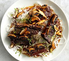 Flanked-Style short ribs, used for Korean barbecue, are cut across the bones instead of between the bones. Start this recipe ahead of time; chilling the ribs after braising keeps them from falling falling apart when they served (and all braised meats taste better the next day).
