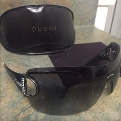 Gucci 2711 sunglass Authentic Gucci 2711 sunglass in black. These glasses are in good condition. Comes with original case and cleaning cloth shown in picture. No stones missing. Gucci Accessories Sunglasses
