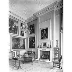 The smoking room at Easton Neston. The room retains the wall linings and cornices of Nicholas Hawksmoor, who designed the house in 1702. The chimneypiece is a later 18th century addition.  from Country Life, 1927
