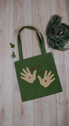 Canvas Tote with Kid's Hands Applique and Hearts, Functional Bag, Gift for Mom. I create this tote as a Symbol of Kid's Love - hands which hold hearts and give them for the dearest person in the world - for Mommy. Enjoy my bag! Ooak, handmade, 35 $. You can buy it here: http://etsy.me/2EJYuz6 #etsy #airyfairybags #green #mothersday #canvastote #functionalbag #giftformom #mothergift #workoutbag #shoulderbag #momslife #formommy #mommylove #ilovemommy #mommybag #kidslove #formother…