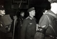 Circa 1940: Captured German airman being escorted by military police on his arrival at a London railway station (Photo by Popperfoto/Getty Images)