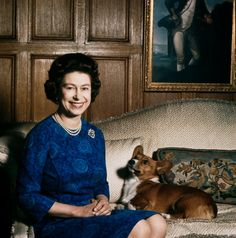 Queen Elizabeth II with one of her corgis at Sandringham, 1970. Photo by Fox Photos/Hulton Archive/Getty Images