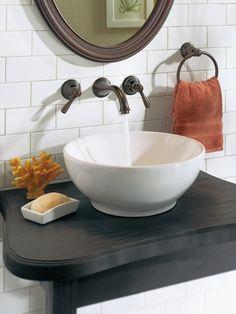 Moen Kingsley Chrome two-handle low arc wall mount bathroom faucet.