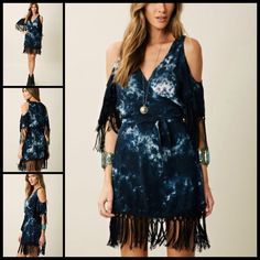 BLU MOON 🌚 Blue Tie Dye Wrap Dress NWOT Boho at its best!! i may change my mind on this one!  We will see!  this may be my black lace up boots new best friend!  Mini with an adjustable wrap silhouette, v-neck, kimono sleeves with cutouts and fringe trim, fringe trim at hem and adjustable tie at waist. 💯Rayon. Dry clean. NWOT blu moon Dresses