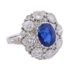 A sapphire and diamond cluster ring by Buccellati, sapphire weighs approximately…