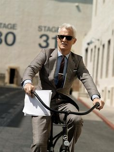 OMG. STERLING ON A BIKE. He's my favorite silver fox, especially in those fantastic Mad Men clothes.