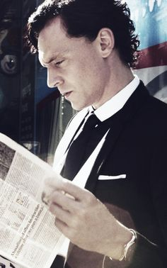 Just casually reading the paper while looking sexy as hell.
