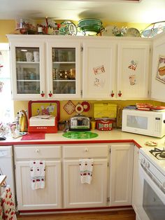 Cherry Kitchen - love how they echoed the look of a Hoosier cabinet with their color and material choices!