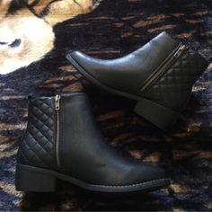 "Black Ankle Booties Black ankle booties/vegan leather upper/side zipper closure/zipper accent on opposite side panel/textured-quilted vegan leather decor on rear shaft/pull tab on top rear/round toe/rubber outsole/heel height: 1.5"" approx/shaft height: 4.5""/opening: 9.5 approx/new in box/thanks for looking                                                                   ❌No Trades❌                                                       ❌No PayPal❌ Shiek Shoes Ankle Boots & Booties"