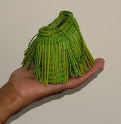 Kete Piupiu is made of flax (harakeke) the Puipui are half flax and half Muka Flax fiber). By using a Paua shell to strip the husk fibre off the flax leaving a beautiful white fibre known as Muka.  The Kete has been dyed a soft geen colour.