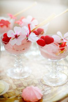 The best way to serve strawberry ice cream: gold spoons, fluted dessert bowls, and topped with raspberries and flowers