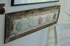 Encaustic painting, Salvaged door panel, pale circles. via Etsy.