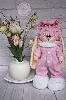 """If you have Bunny doll and do not know how to dress it up, then this knitting pattern is for you! This soft set would please everyone. The knitting pattern """"Raffaello"""" consists of 32 pages in PDF format. It includes more than 70 photographs and step-by-step detailed instructions of 5 elements of clothes (cap, overalls, body, slippers and scarf) for 32 cm Bunny doll (12.5 inches) + my advice and respond to a question at any type of knitting."""