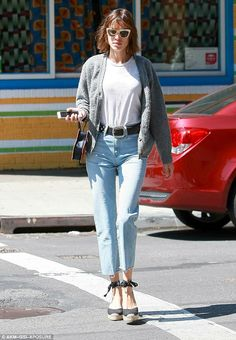 Style staples: Wearing a plain white tee tucked in to a pair of high-waisted jeans, she lo...