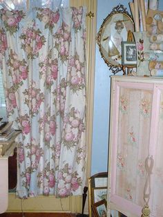 Love the vintage wallpaper on the armoire panels