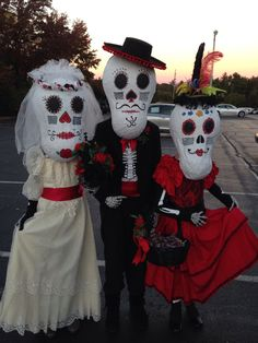 Day of the Dead Wedding! Made paper mache masks and recycled clothes and old costumes for this First Place creation.