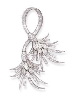 A DIAMOND BROOCH   Designed as twin stylized palm trees, centering upon marquise-cut diamond clusters, extending vari-cut leaves to the baguette-cut diamond scrolling trunks, mounted in platinum