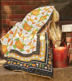 Ghosts and goblins surround traditional Shoo Fly and Monkey Wrench quilt blocks for a Halloween throw quilt pattern kids of all ages will love! Spook-tacular, by Janice Averill, is tons of fun! Get the quilt kit while supplies last.