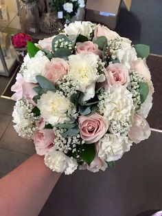Bridal wedding bouquet of soft pink sweet avalanche roses, white carnations, gyp and foliage's  By Emma's Florist  www.emmasflorist.com