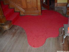 Blood pool rug. Could probably be made with cheap rugs or discount cloth.