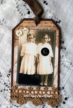 Vintage photo & lace & buttons on tag.