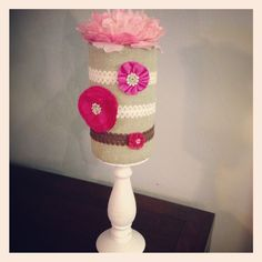 Headband holder I made for a Baby Shower. I glued Burlap to an Oatmeal container. Glued a flower on top. Then hot glued the whole thing to a candle holder. All supplies found at Hobby Lobby.