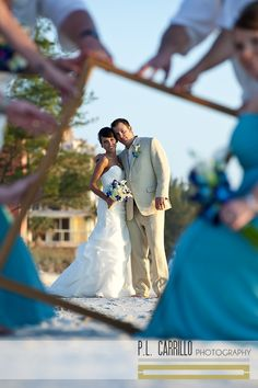 A Sunset Beach Wedding • Picture frame pose. P.L. Carrillo Photography