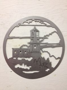 Hey, I found this really awesome Etsy listing at https://www.etsy.com/listing/201790489/metal-lighthouse-wall-hanging-12-x-12