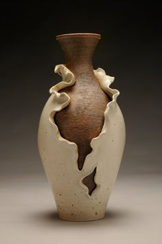 Vanessa Quintana The idea behind this is the shedding of skin to reveal the raw, natural state that lies within the boundaries and expectations of the traditional vase form