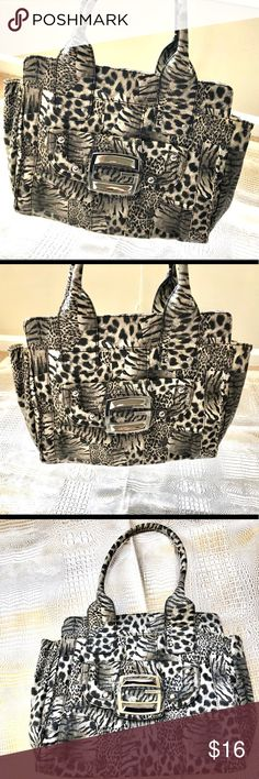 """Guess Zebra Print Handbag Purse Preowned. Has some peeling around the outside edges. See last pic. Faux leather with decorated lining. One large side pocket at the buckle and 3 compartments inside. Adorable bag!   Measurements are as follows:  Width 14"""" Height 12"""" Depth 6"""" Strap Drop 10"""" Guess Bags Shoulder Bags"""