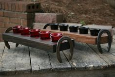 votive candle holder with horse shoe handles