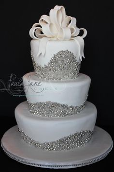 Beautiful Ribbon Loops on top of Silver Sparkled Wedding Cake