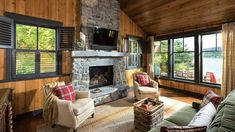 To ensure cozy lodging year round, an air-to-air heat exchanger with a gas fireplace for backup was installed in the cabin, which, before the Dixons, had been used only in summer. The stone for the fireplace was selected to complement the scale of the living room.