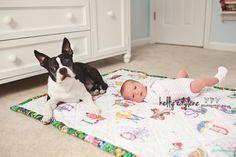 newborn and puppy