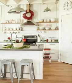Industrial/cottage kitchen.  Great blend of hard finishes and soft details.