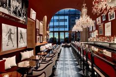 The bar area—with its velvet and leather upholstery, crystal chandeliers, and 60-foot bar—looks out onto a French-style landscaped terrace with views of MoMA. Delicious cocktails are served in Baccarat glassware.