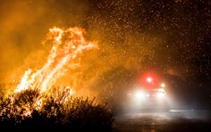 California Wildfires - December 7, 2017.  Firefighters work to extinguish the Thomas Fire as it burns past the 101 Highway towards the Pacific Coast Highway in Ventura, California on Dec. 7.