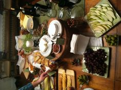 Wine and cheese party tablescape with multi levels