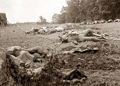 civil war pictures | Gettysburg, Pennsylvania Confederate dead gathered for burial at the ...