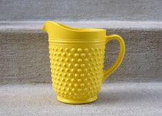Large Milk Glass Pitcher Vase - Painted Yellow Hobnail - Retro. $22.00, via Etsy.