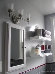 Floating shelves behind toilet for extra hand towels and other stuff.  Painted blue too!