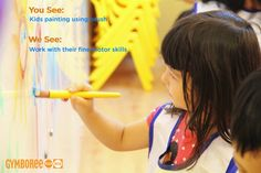You See: Kids painting using brush  We See: Working with their fine motor skills
