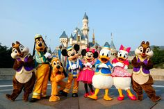 Chip, Goofy, Pluto, Mickey, Minnie, Donald, Daisy, and Dale outside the Disneyland castle